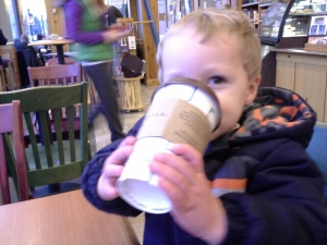 I'd bet good money that cup is either empty or has hot chocolate in it since Aaron is only 2 and is hyper enough as it is. But it's still a beautiful and adorable visual.